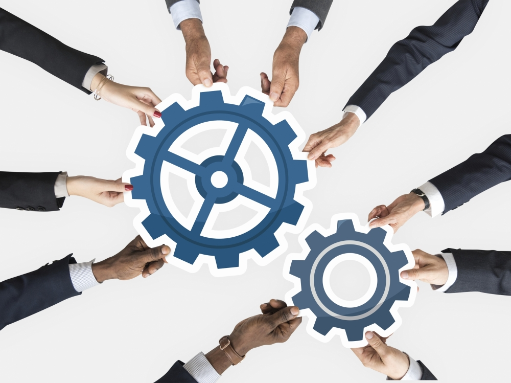 gears-merger-business-scaled-e1614631283106